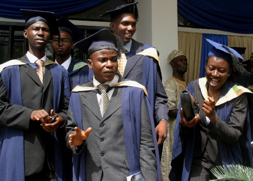 Students of the University of Ibadan check their graduation gowns in their campus in Ibadan, south west Nigeria, November 15, 2006. A visitor to Ibadan University in pre-independence Nigeria more that 50 years ago was impressed by its modern structure and 100,000-book library. Since then, Nigeria's premier university, which started in 1948 as a University of London college, has come down in the world. Today, run-down faculties with paint peeling off walls, and crowded, scruffy student hostels testify to its decline. To match feature AFRICA-EDUCATION-UNIVERSITIES. REUTERS/George Esiri (NIGERIA) - RTR1JD1R