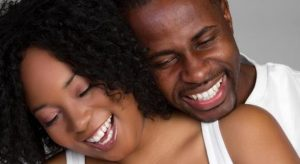 black-couple-smiling-candid