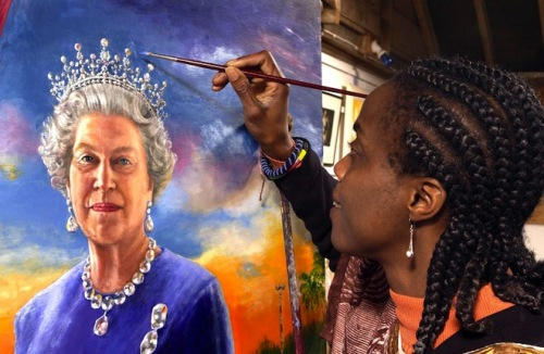 Nigerian artist Chinwe Chukwuogo-Roy adds the finishing touches to a  portrait of Britain's Queen Elizabeth II commissioned by the Commonwealth  to mark her 2002 Golden Jubliee March 10, 2002. [The picture shows the Queen, who is Head of the Commonwealth, standing at the window of a room in Buckingham Palace with  a composite view of some of the best known sights in the Commonwealth in the background.] - RTXL4VH