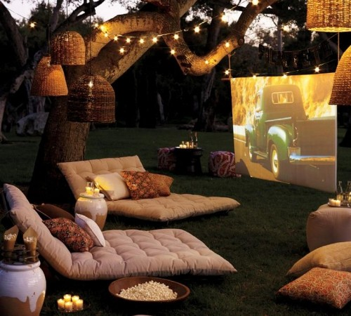 outdoor-cinema-with-soft-furishings-under-tree-with-romantic-lighting-801x721