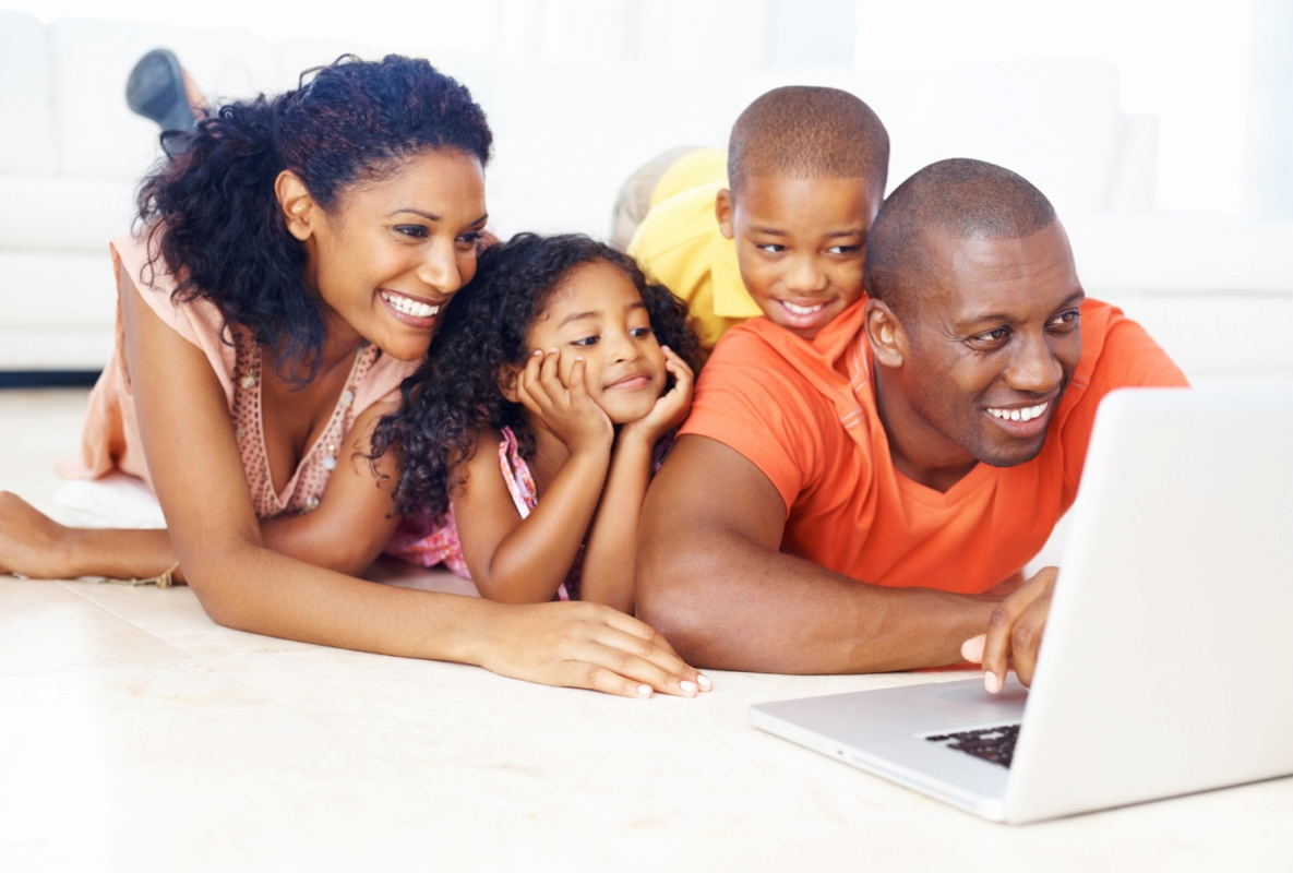 African American family using laptop