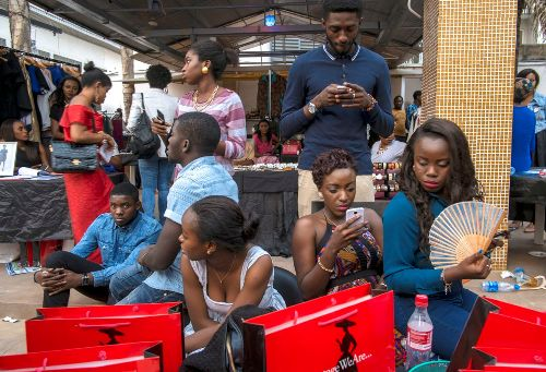 02 Feb 2014, Lagos, Nigeria --- Nigerian youth in Lagos gather during a shopping celebration where young fashion entrepreneurs gather to show their latest trends and business possibilities. --- Image by © Carlos Cazalis/Corbis