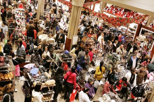 NEW YORK - NOVEMBER 24: Shoppers crowd the floor at Macy's the day after Thanksgiving November 24, 2006 in New York City. Many shoppers venture out for early deals as the Christmas shopping season gets under way where according to the National Retail Federation; 137 million shoppers are expected in stores on Black Friday. (Photo by Stephen Chernin/Getty Images)