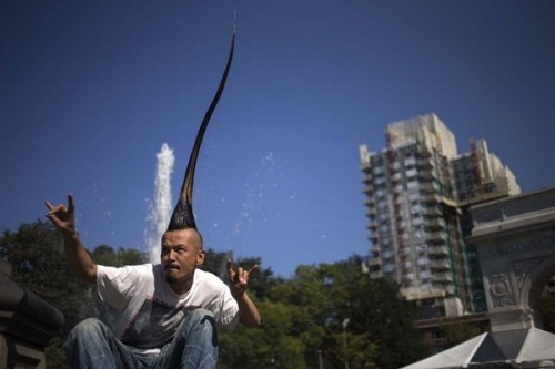 "Japanese fashion designer Kazuhiro Watanabe, who holds the world record for the ""Tallest Mohawk,"" poses for a photographer at a media event held by the Guinness World Records to launch their 2013 book edition in New York September 12, 2012. According to the Guinness World Records, Watanabe's do stands at 3 feet 8.6 inches. REUTERS/Adrees Latif (UNITED STATES - Tags: FASHION SOCIETY)"