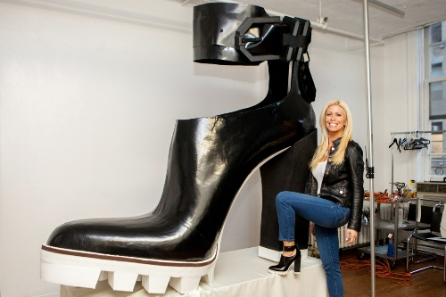 "New York - November 10, 2014: For Features - Fashion Contributor to the TODAY show, Jill Martin poses in front of the World's biggest shoe as determined by the Guinness Book of World Records. Martin contacted Kenneth Cole in the hopes of getting him and his team to attempt the world's record. This style of shoe, the Otto is the most popular style for Kenneth Cole and the National Ad Shoe for Fall 2014. It was also used as the guide for the attempt to build the worlds biggest shoe shown here at 6'5"" long by 6'1"" tall. Credit: Lorenzo Ciniglio/Freelance"