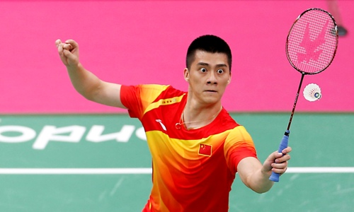 China's Yun Cai and Fu Haifeng (pictured) play against Australia's Ross Smith and Glenn Warfe during their men's doubles group play stage badminton match at the Wembley Arena during the London 2012 Olympic Games July 28, 2012. REUTERS/Bazuki Muhammad (BRITAIN - Tags: SPORT BADMINTON SPORT OLYMPICS TPX IMAGES OF THE DAY)