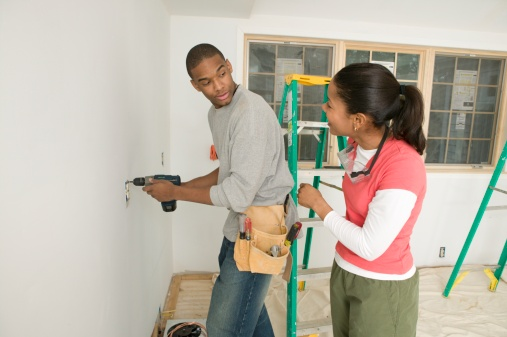 Male carpenter using a power drill