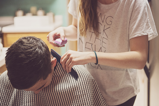 Hairstylists Giving a Haircut