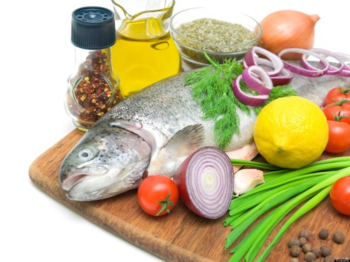 fresh trout, vegetables, lemon, olive oil and spices on a cutting board on a white background close-up; Shutterstock ID 126063212; PO: The Huffington Post; Job: The Huffington Post; Client: The Huffington Post; Other: The Huffington Post