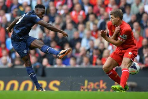 TOPSHOTS Manchester United's English striker Danny Welbeck (L) has his shot blocked by Liverpool's English midfielder Steven Gerrard (R) during the English Premier League football match between Liverpool and Manchester United at the Anfield stadium in Liverpool, northwest England, on September 1, 2013. AFP PHOTO / PAUL ELLIS RESTRICTED TO EDITORIAL USE. No use with unauthorized audio, video, data, fixture lists, club/league logos or live services. Online in-match use limited to 45 images, no video emulation. No use in betting, games or single club/league/player publications.PAUL ELLIS/AFP/Getty Images
