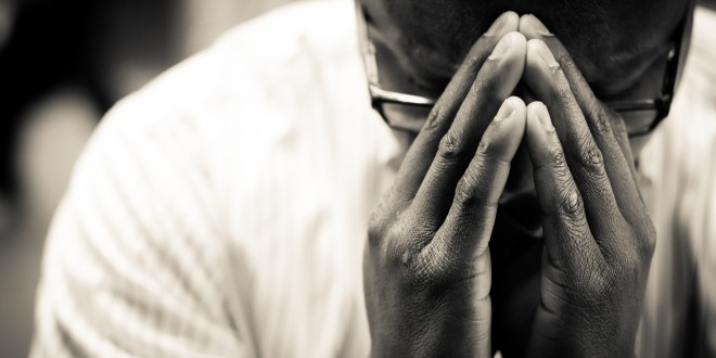 Man-In-Prayer-Christian-Stock-Photo-660x330