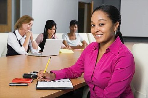 woman-in-pink-shirt-at-business-meeting