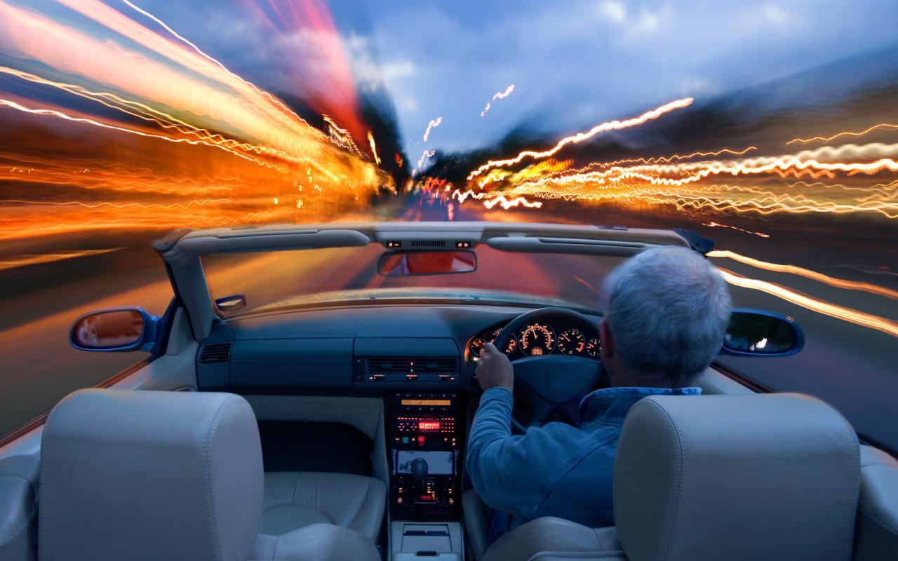 man-driving-at-dusk-xlarge
