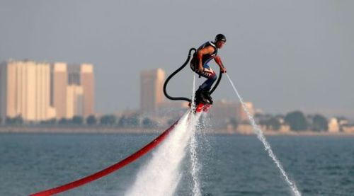 David Goncalves of France competes in the first FlyBoard World Cup qualifications in the Qatari capital Doha on October 19, 2012. AFP PHOTO/KARIM JAAFAR == QATAR OUT ==