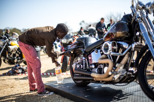 05 JULY, 2014 - A bike is cleaned at the Classic Motorcycle Club's 1000 Bike Show at Germiston High School in Johannesburg. The show held a concours competition for the best in show. The show showcased some of South Africa's best preserved and restored vintage motorcycles. Picture: DANIEL BORN ©