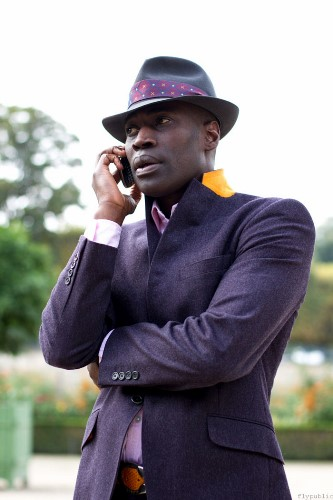 contrast-lapel-blazer-black-man-in-hat-on-cellphone