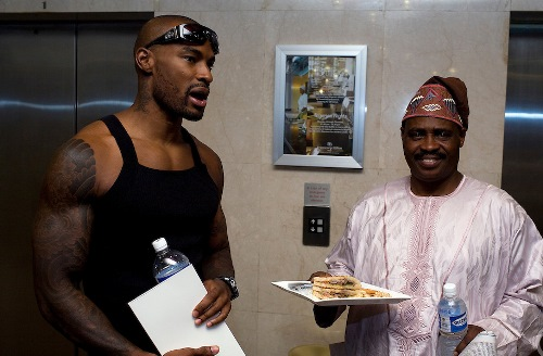 A Nigerian man with a sandwich talks with male super model Tyson Beckford during the 3rd Annual ThisDay festival July 12, 2008 in Abuja, Nigeria. The annual festival is designed to raise awareness of African issues while promoting positive images of Africa using music, fashion and culture in a series of concerts and events in Nigeria, the United States and the United Kingdom.