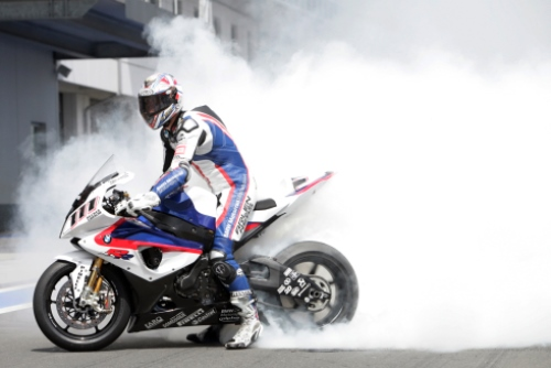 Monday, 20 July 2009, Nurburgring. Germany. BMW Sauber F1 Team Race Club Fan Event. BMW Motorrad Motorsport Rider Ruben Xaus (ESP) makes a burn out on the BMW S 1000 RR. This image is copyright free for editorial use © BMW AG