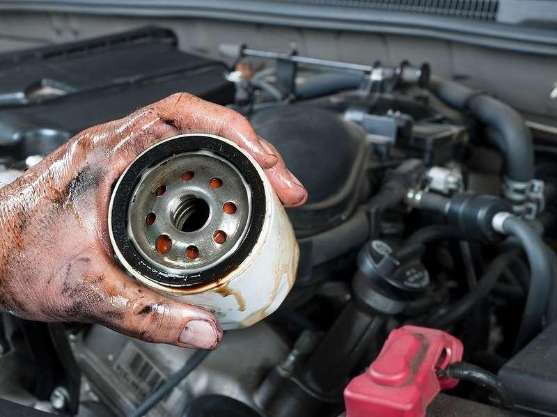 bigstock-An-auto-mechanic-shows-an-old--41813287