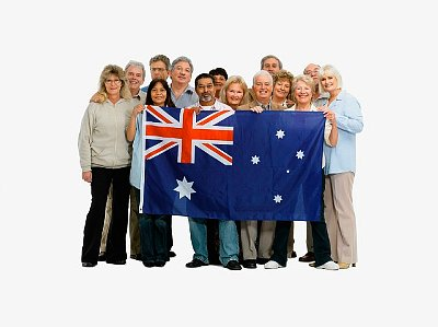 Group of people holding an Australian flag --- Image by © momentimages/Tetra Images/Corbis