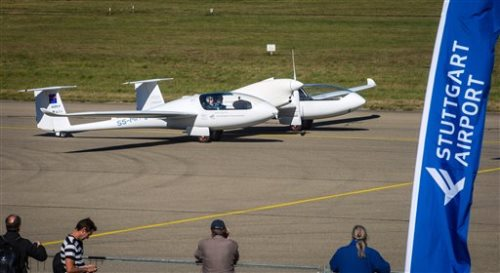 The world's first four-seater plane HY4 that uses emission-free hybrid fuel-cells to fly is pictured at the airport in Stuttgart, Germany, Thursday, Sept. 29, 2016. A 10-minute test flight Thursday at the airport in southwestern Germany involved two pilots and two dummy passengers. (Christoph Schmidt/dpa via AP)