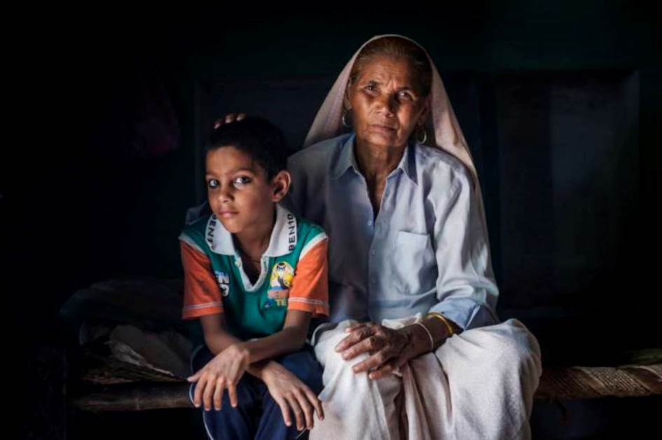 *** EXCLUSIVE - VIDEO AVAILABLE *** MEERUT, INDIA - JULY 28: Omkari Singh and her son Akashvani pose for a photograph at their house on July 28, 2014 in Meerut, India. MEET Omkali Singh, 80, who is mother to a six year boy Amritwani. She became the worldís oldest mother in 2008 when she gave birth to twins at the age of 74, and now lives with her husband and sonís father Charan, 89, in Utter Pradesh in northern India. The female twin, Barsaat, tragically passed away at the age of four, but Amritwani keeps his elderly mother on his feet with his youthful energy. PHOTOGRAPH BY Arkaprava Ghosh / Barcroft India UK Office, London. T +44 845 370 2233 W www.barcroftmedia.com USA Office, New York City. T +1 212 796 2458 W www.barcroftusa.com Indian Office, Delhi. T +91 11 4053 2429 W www.barcroftindia.com