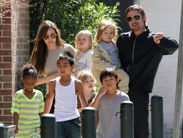 "#7006830 The Jolie-Pitt family headed out in New Orleans, Louisiana to do some grocery shopping at a local market on March 20, 2011. Angelina has brought all six children to visit their dad Brad Pitt while he works on his latest project ""Cogan's Trade"". Maddox, Pax, Zahara and Shiloh walked while the twins Knox and Vivienne hitched a ride from mom and dad who were all smiles while out and about on a lovely sunny day. Brad and Angelina waved to fans as they strolled the street to and from the market. Fame Pictures, Inc - Santa Monica, CA, USA - +1 (310) 395-0500"