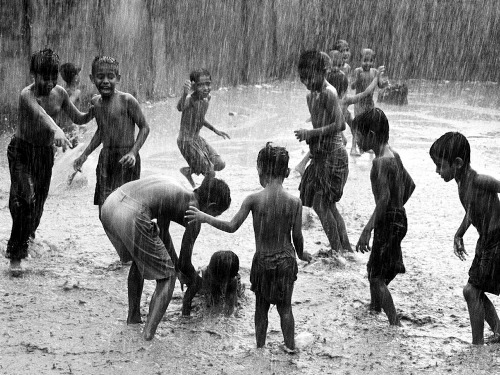 children-play-rain-india_18731_990x7421