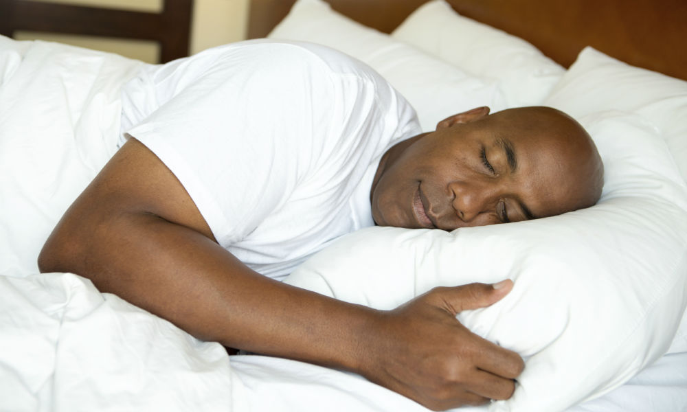 People-black-man-sleeping-in-bed