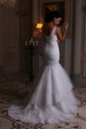 Mermaid style wedding dress with long train